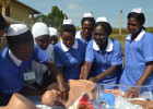 Trainee Midwives in Uganda demonstrating the childbirth process using the Advanced Child birth simulator Anatomical Model donated by UNFPA at the handover ceremony at Public Health Nurses College. Photo: UN Photo.