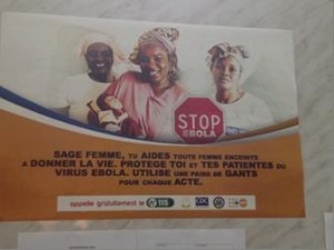 Midwife - protect yourself to protect others, a poster at a health facility in Guinea. Photo: UNFPA